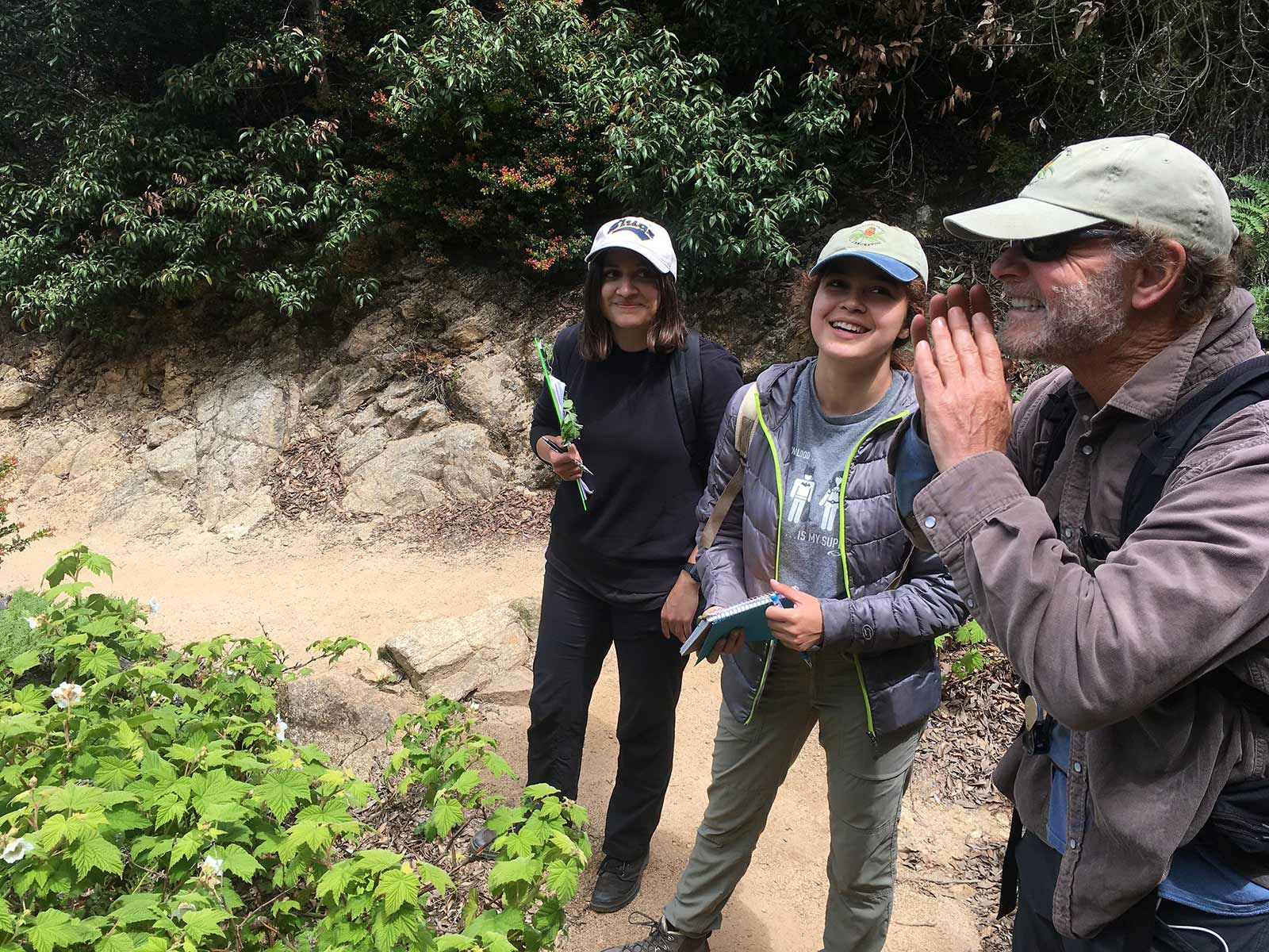 Mariana, Andrea, and California Native Plant Program Director Brett Hall look for the next rapid assessment site for a San Mateo vegetation mapping project. Photo credit: Lucy Ferneyhough, courtesy of University of California Santa Cruz Arboretum.