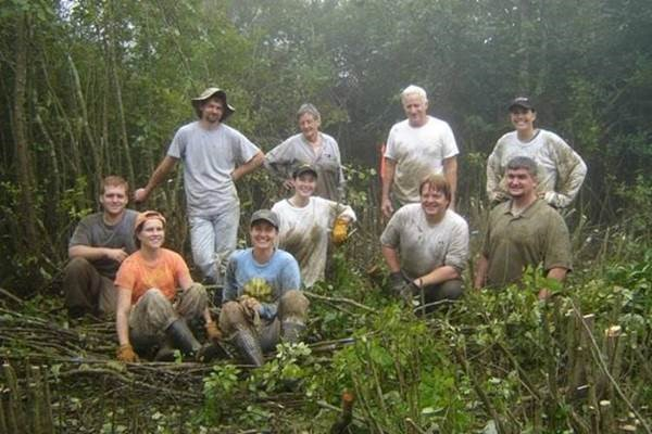 Ceska, front row in blue next to SBG colleague Heather Alley, with GPCA state agency partners and volunteers hand-clearing mountain bog habitat on private land. Photo credit: Anna Yellin, Georgia Dept. of Natural Resources, Wildlife Conservation Section.