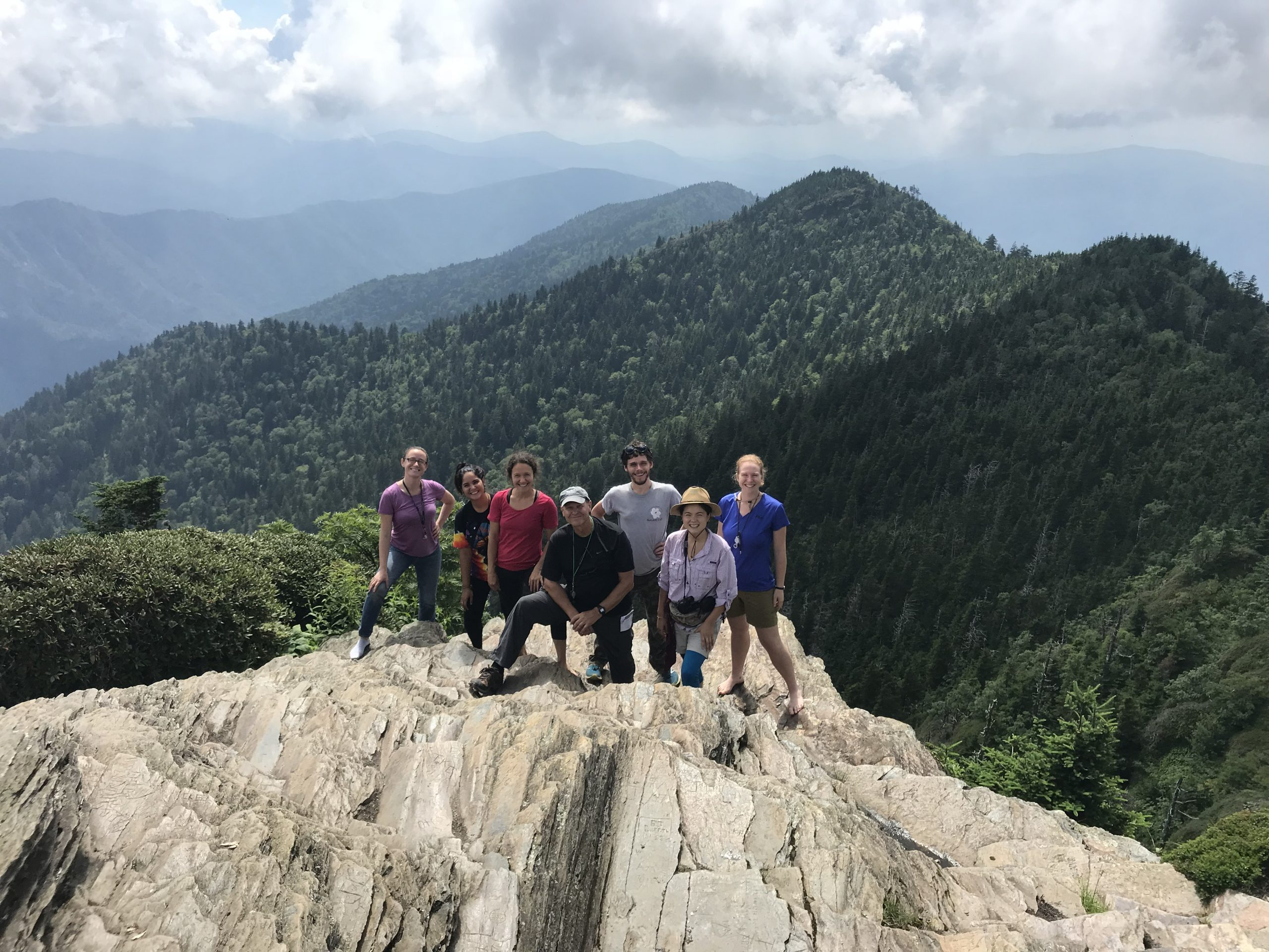 The 2018 Highlands Biological Station field course in introduction to lichens on the culmination of their trip to study threatened endemic species in Great Smoky Mountains National Park. Cliff tops of Mount LeConte, Tennessee.