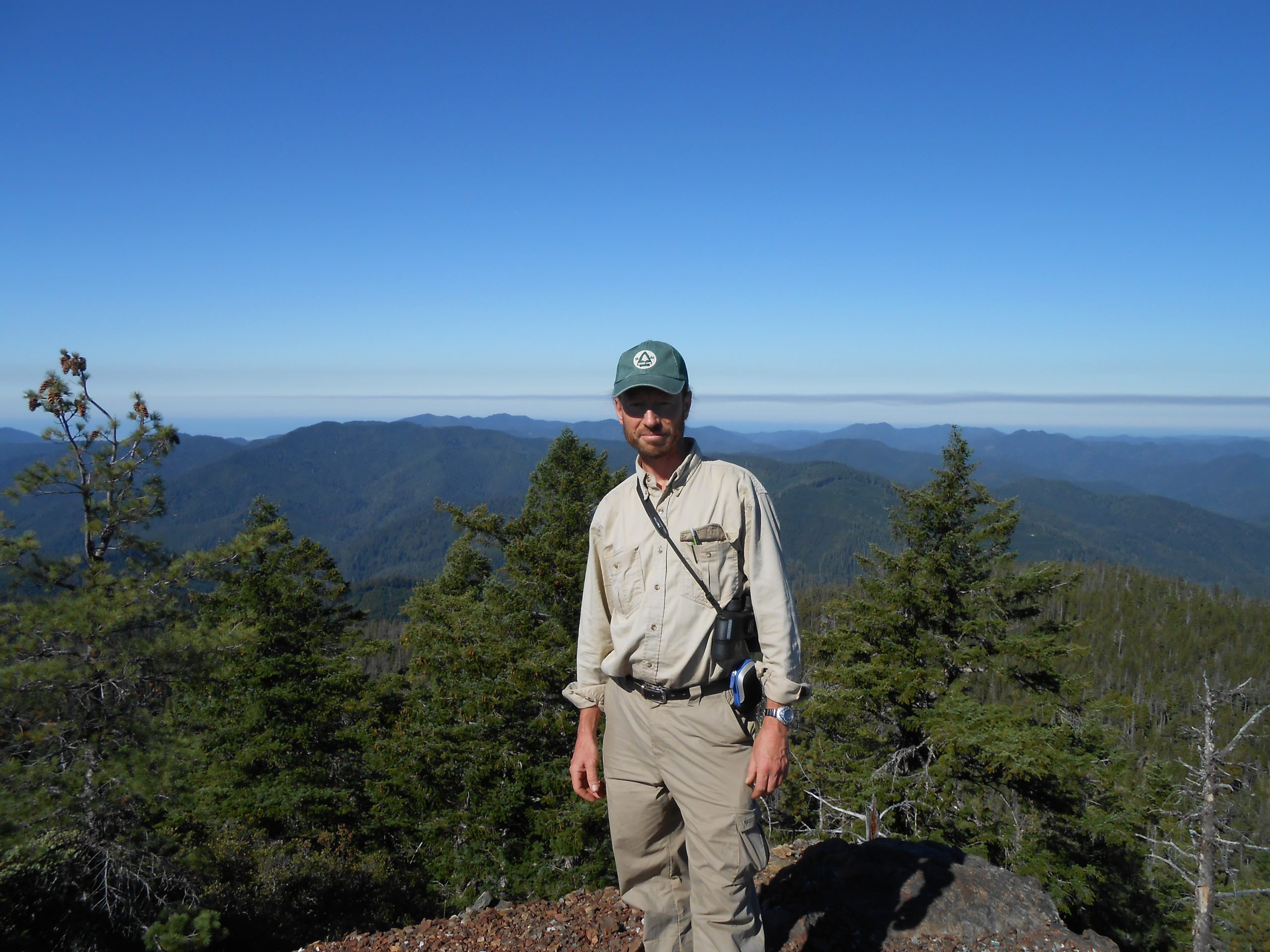 Michael while exploring Iron Mountain in Oregon, and the vulnerable Brewer's spruce (Picea breweriana) found there.