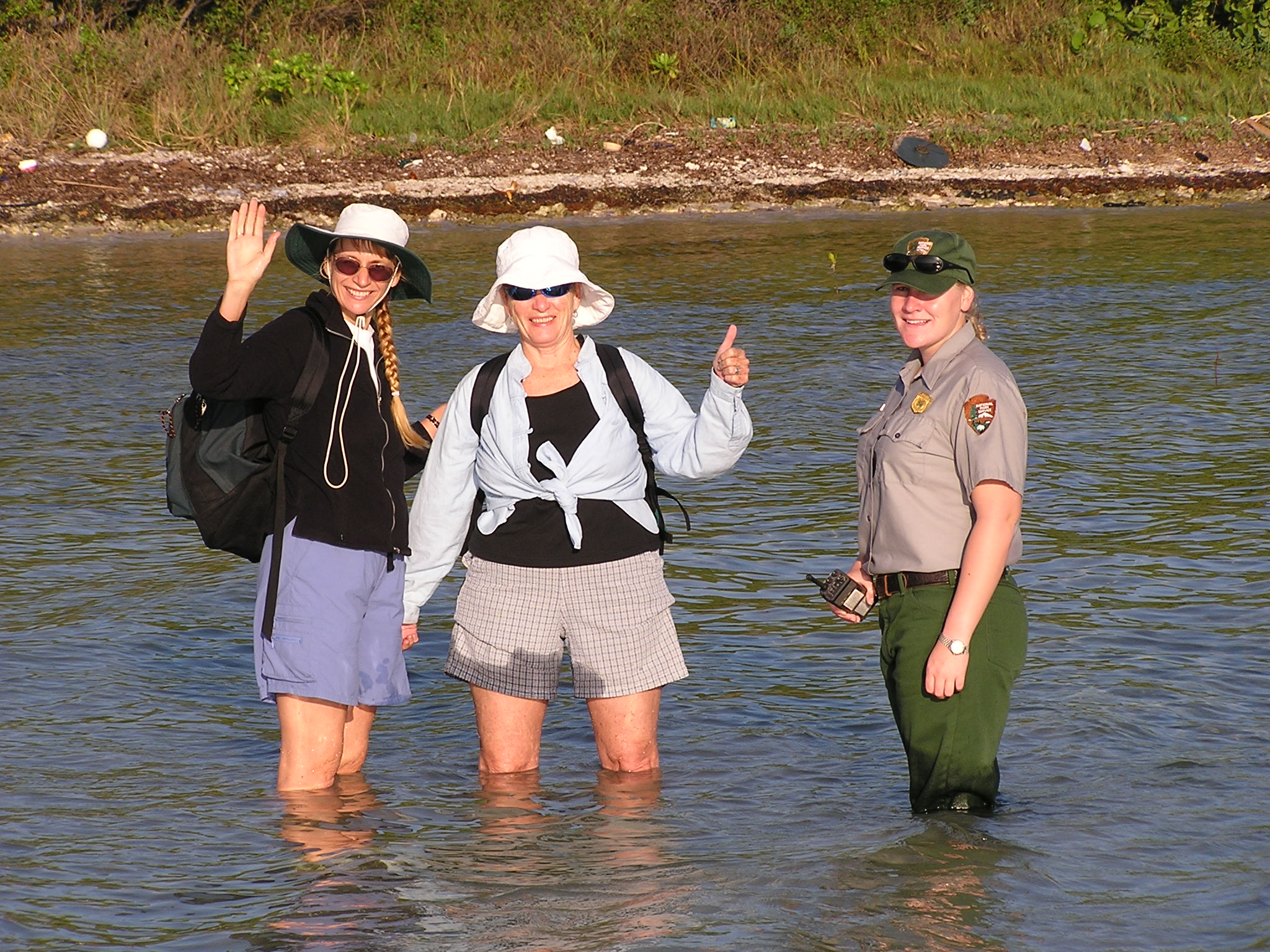 Access to reintroduction sites in Florida sometimes involved wading in shallow waters. Pictured are Joyce Maschinski, Diana Warr and Shelby Moneysmith at Biscayne National Park heading to look for Sargent's cherry palm.