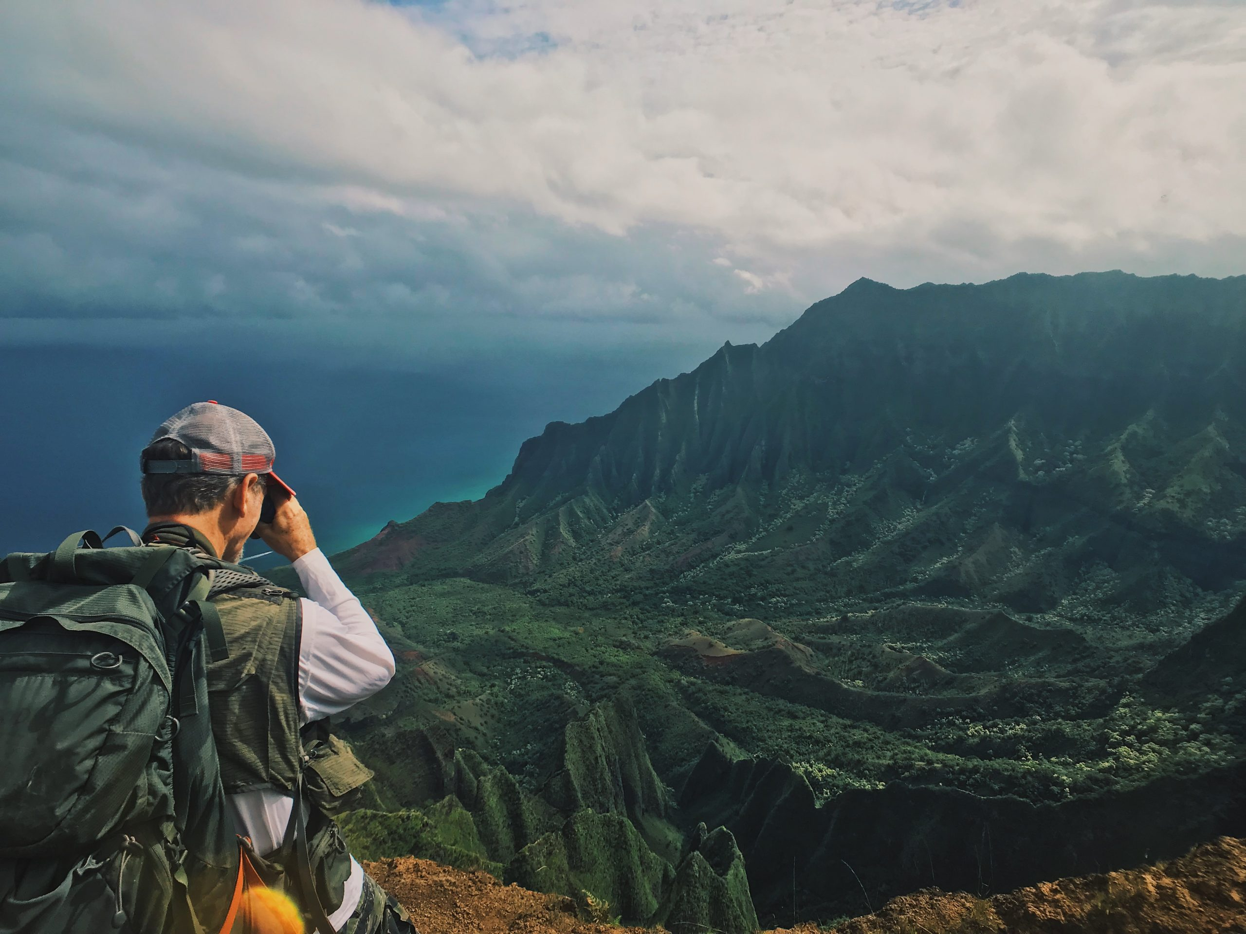 Botanist Ken Wood scopes the rugged terrain of Kaua'i. Even the steepest cliffs can support vegetation, including some rarely seen plant species.