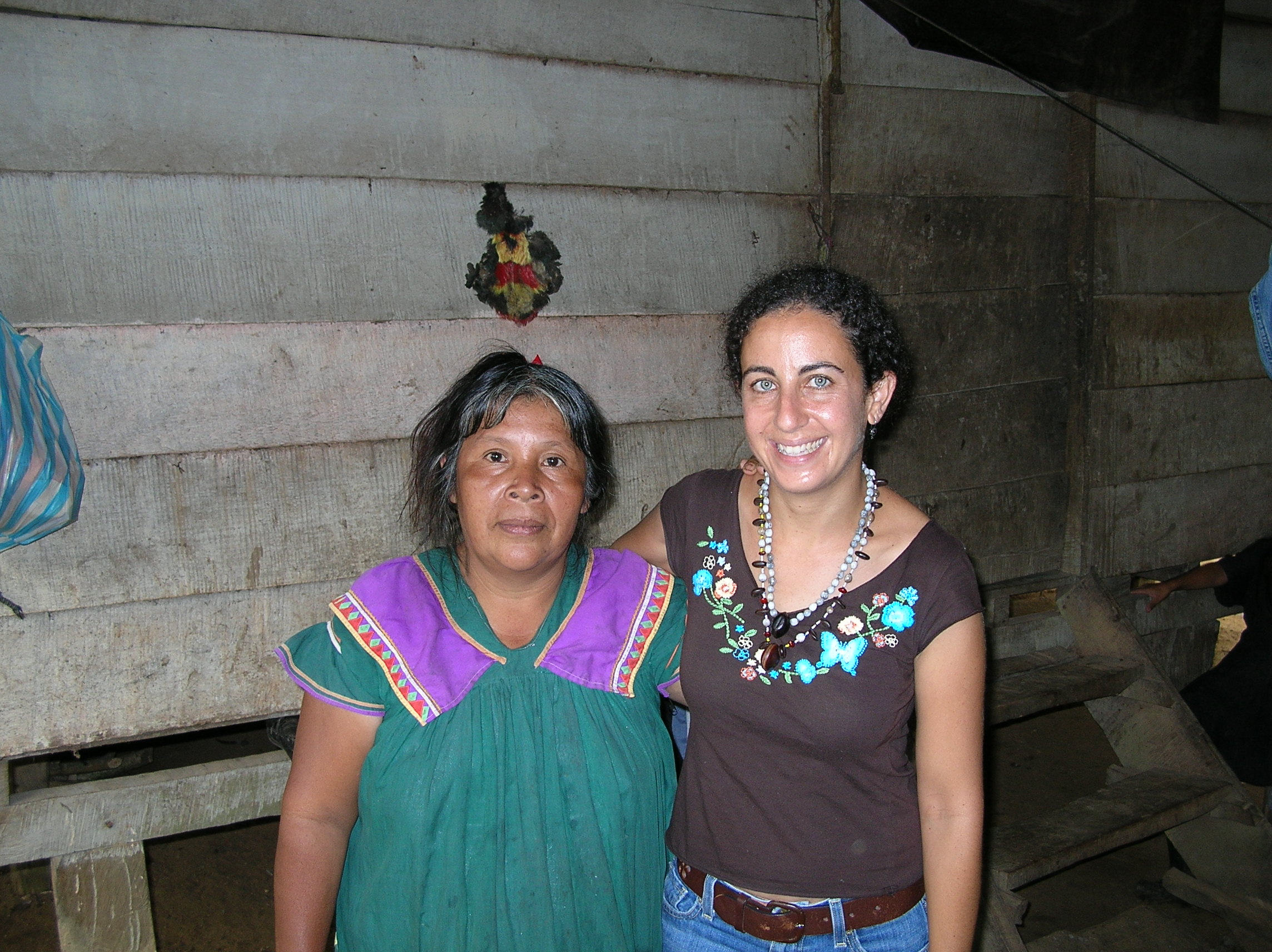 Anne Frances with Maria in front of her kitchen, 2006 visit.