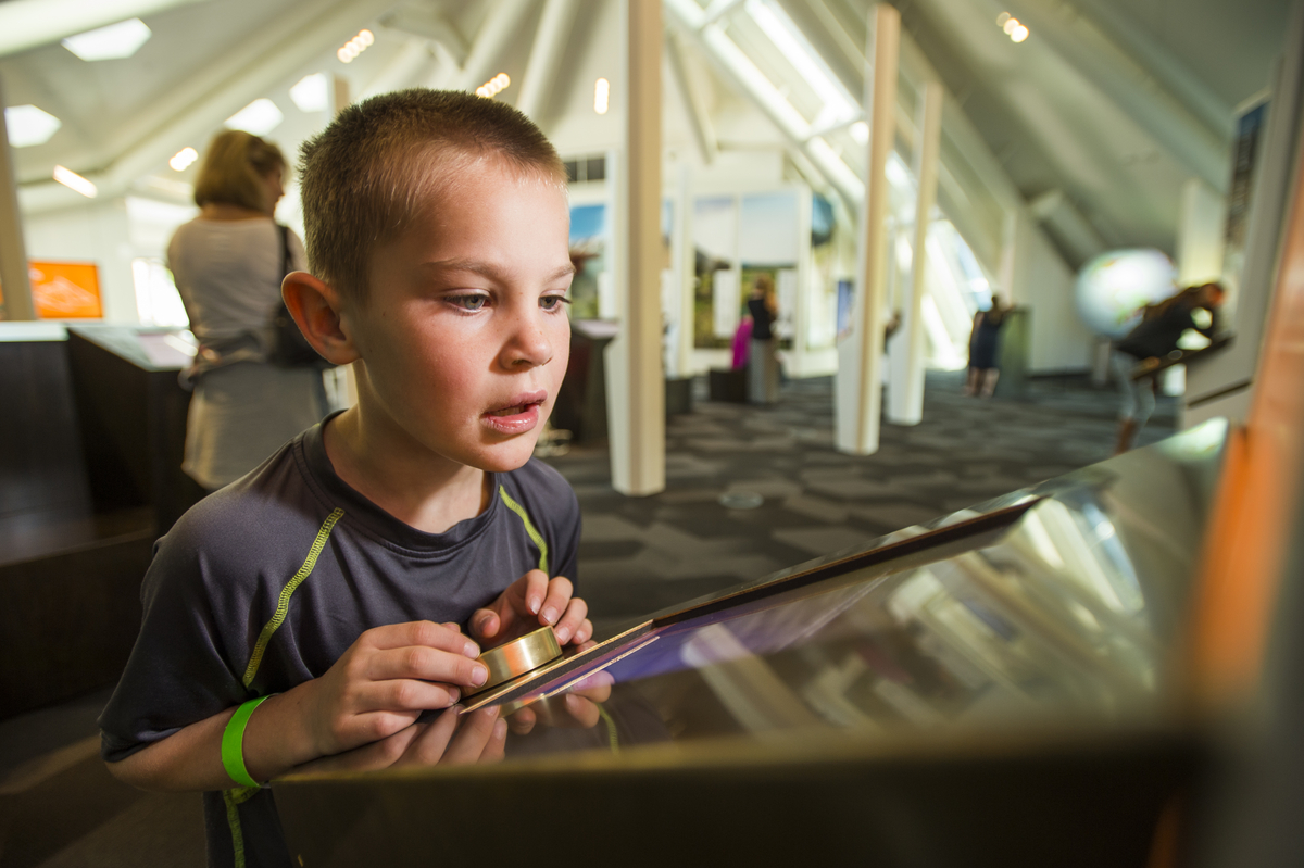 A boy interacts with one of the many technologies providing an engaging outreach experience at the Science Pyramid during Family Science Day.