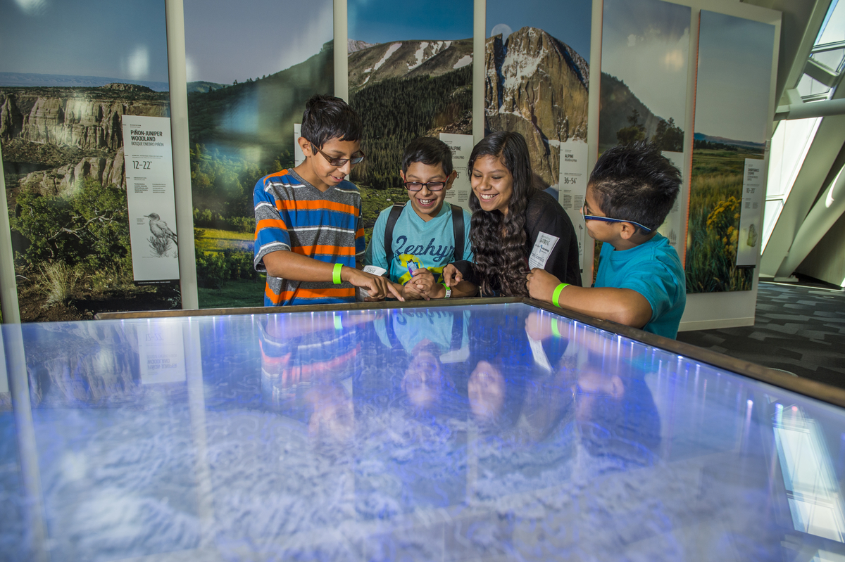 A group of children enjoy exploring the Science Pyramid during Urban Advantage Family Science Day.