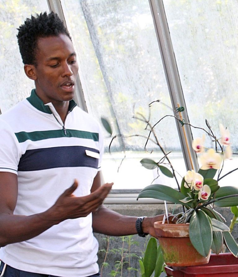 Photo of Jason Ligon, Tissue Culture & Seed Bank Coordinator, Atlanta Botanical Garden teaching orchid care at Lockerly Arboretum