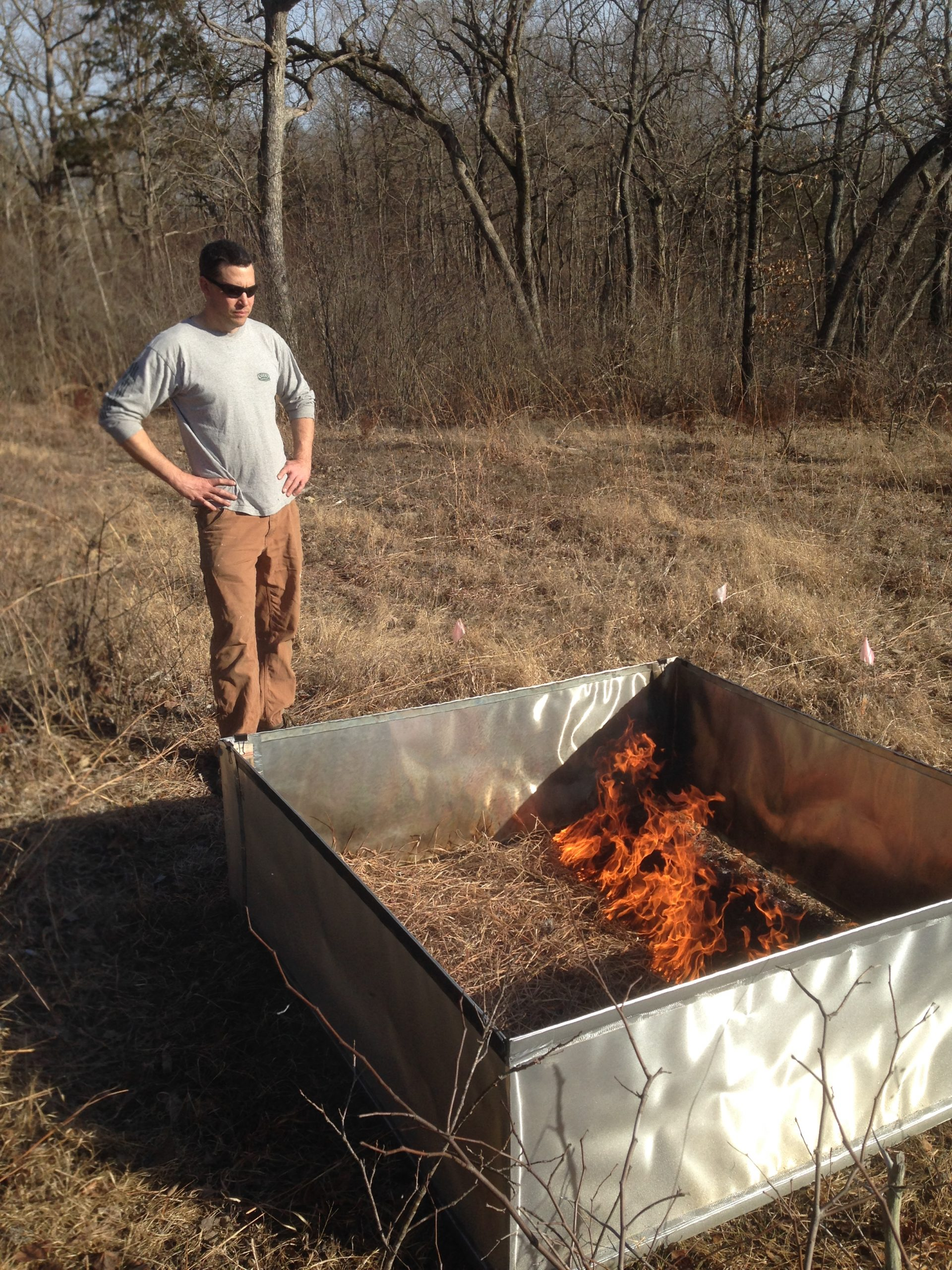 Dr. Albrecht oversees a fire as part of an experiment.