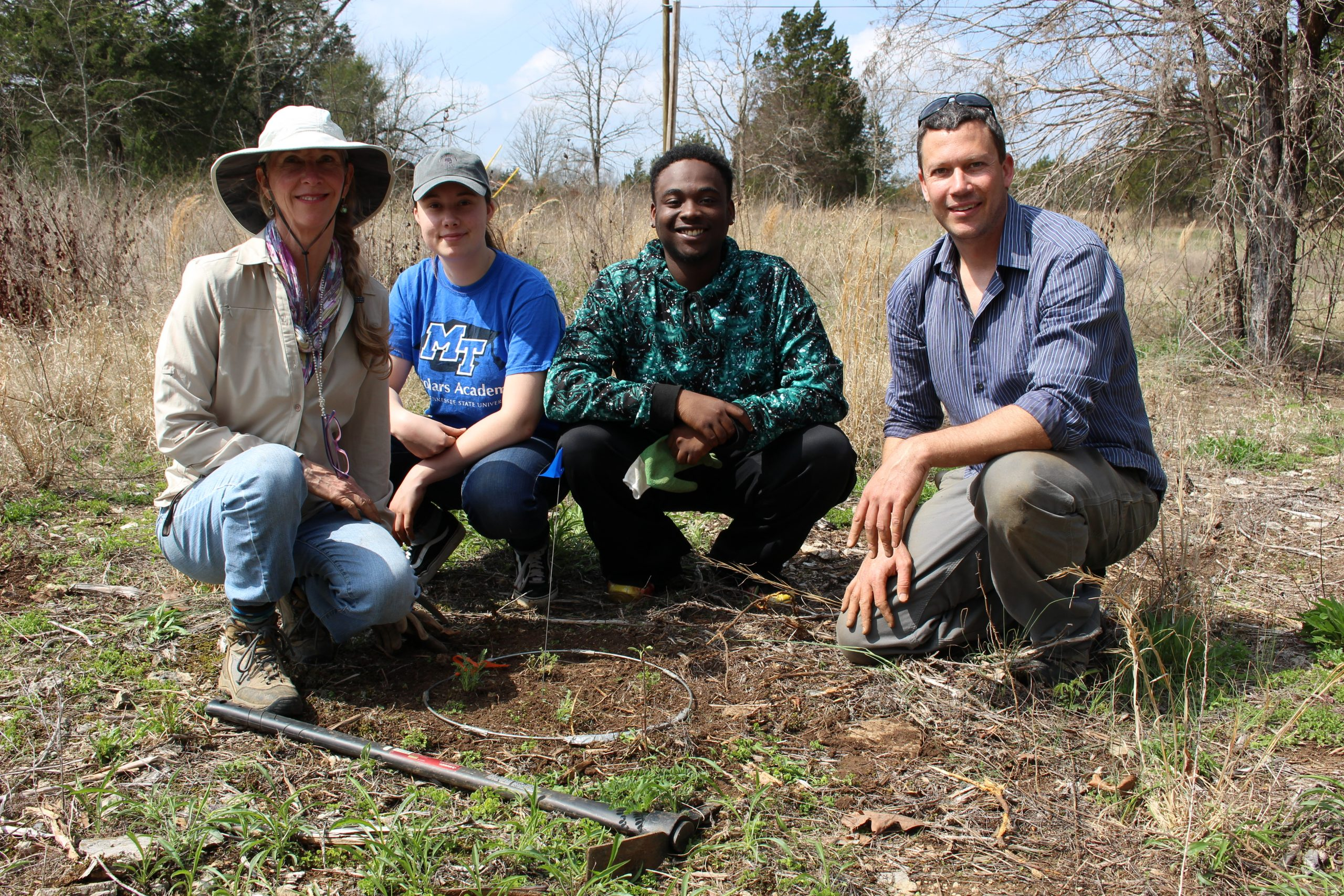 Volunteers join Matthew Albecht in reintroducing Pyne's ground plum (Astragalus bibullatus).