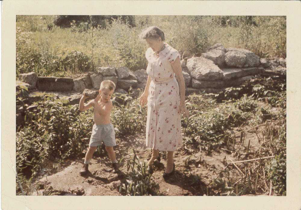 Photo of Spencer Crews spending time with plants and his grandmother, Bernice Crews, who taught him how to grow plants from seed.