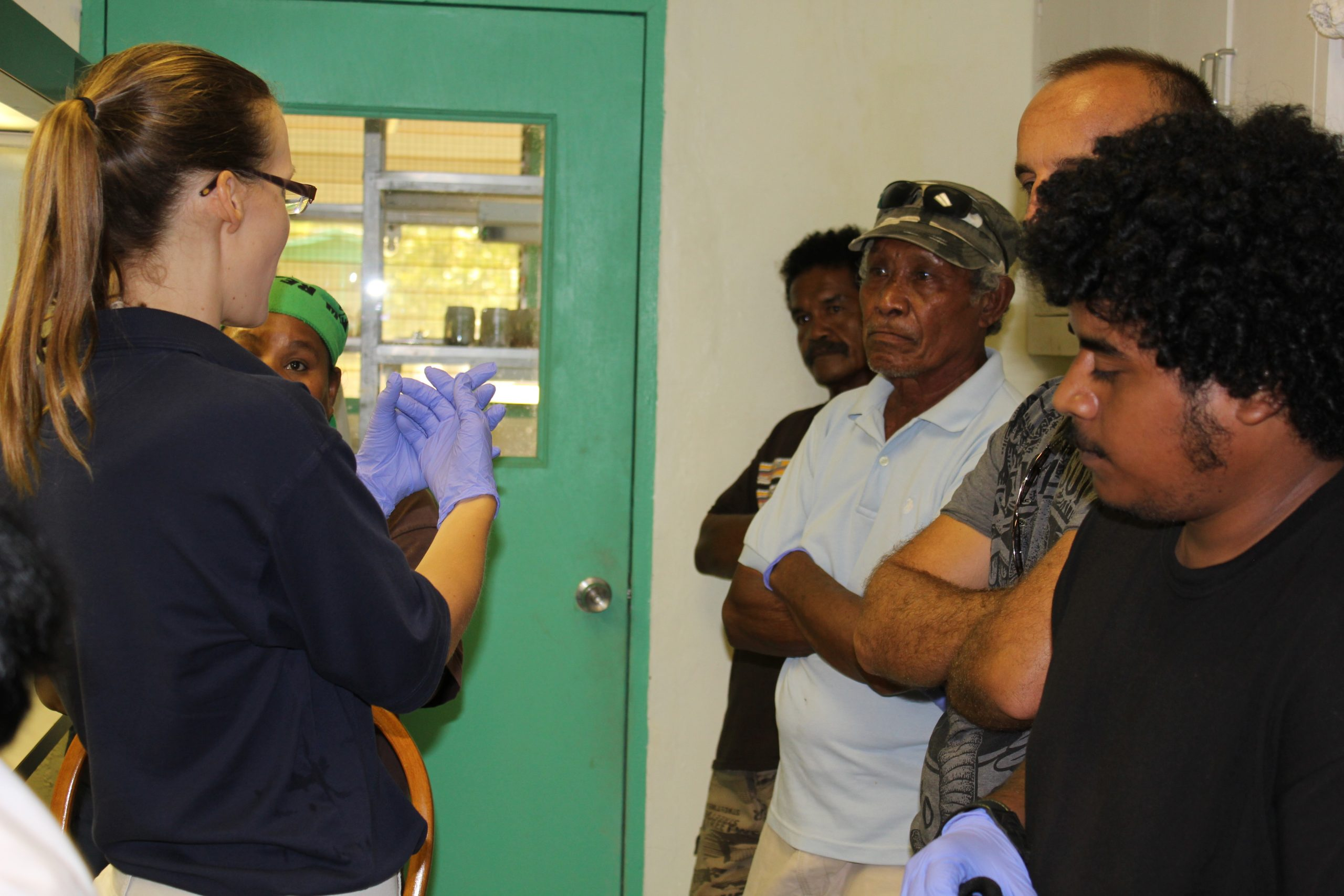 Christy explaining sterile lab techniques in Palau. Photo by Stacy Anderson.