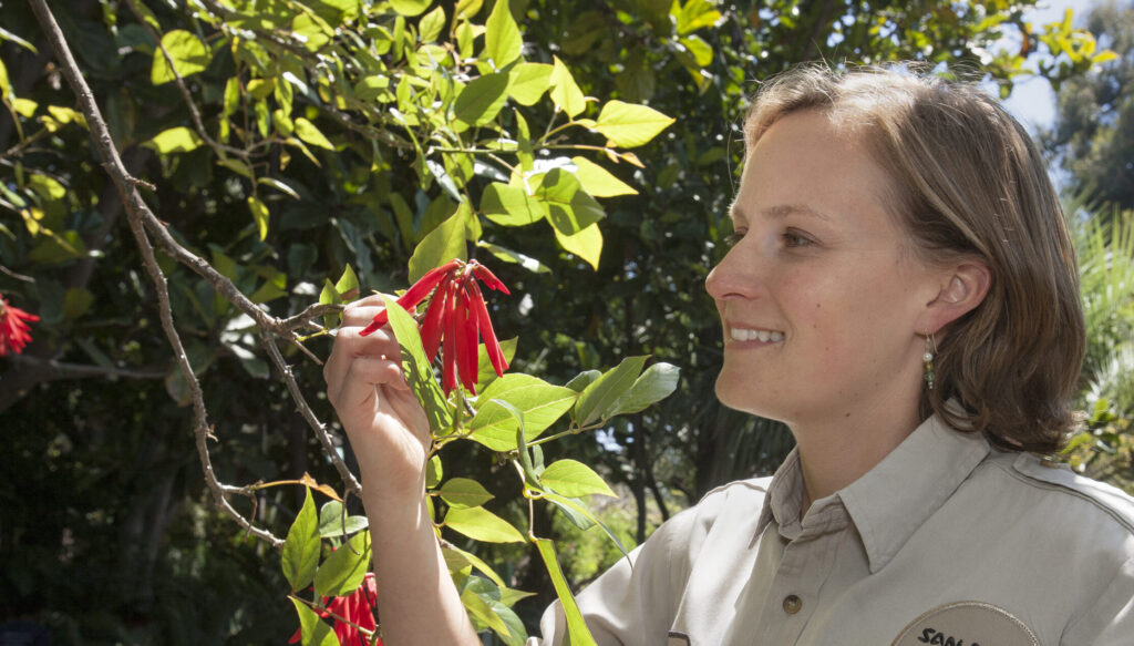 Image of Christy Powell with a coral tree.