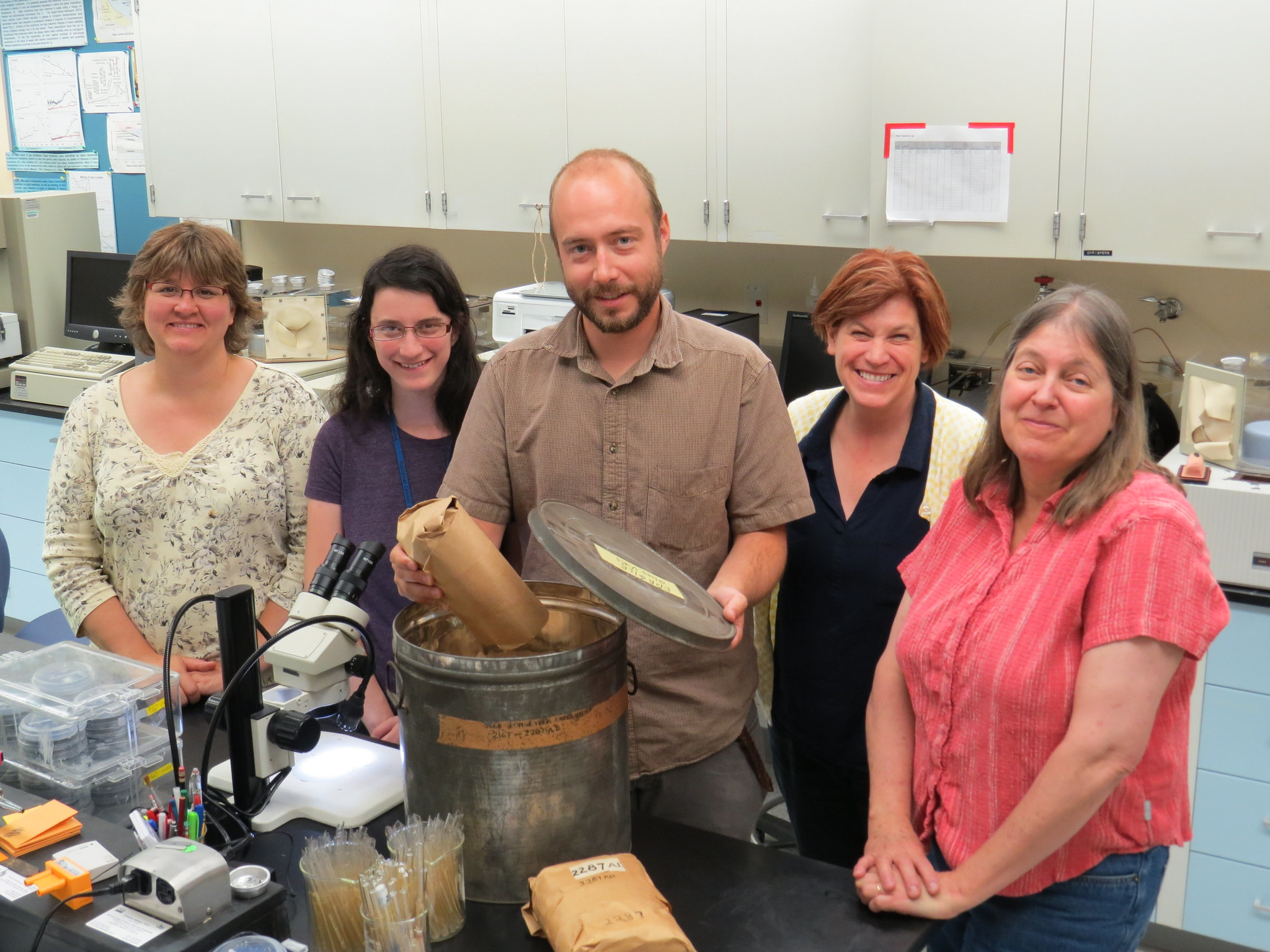 Group shot of Evan Meyer, then seed bank manager at Rancho Santa Ana Botanic Garden (center), and high school intern Veronica Sondervan (second from left) joined NLGRP staff in testing a batch of seed in 2014.
