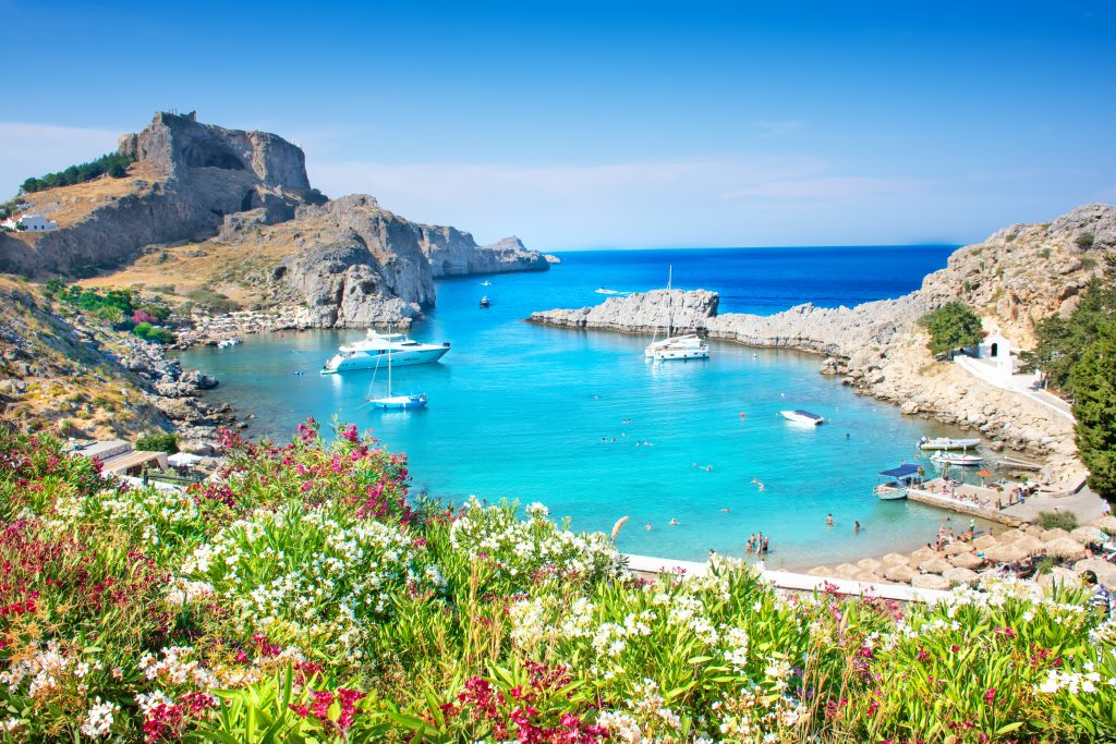 Image of Lindos – panoramic view of St. Paul bay with acropolis of Lindos in background (Rhodes, Greece)